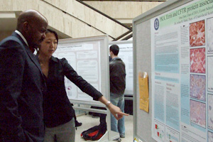 Dental student Vina Zinn explains the findings of her study to me.