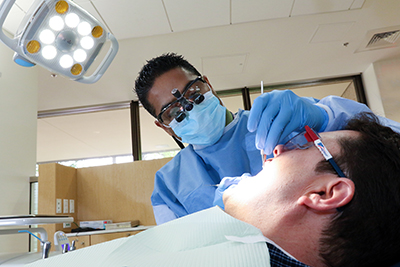 Dental student working on a patient