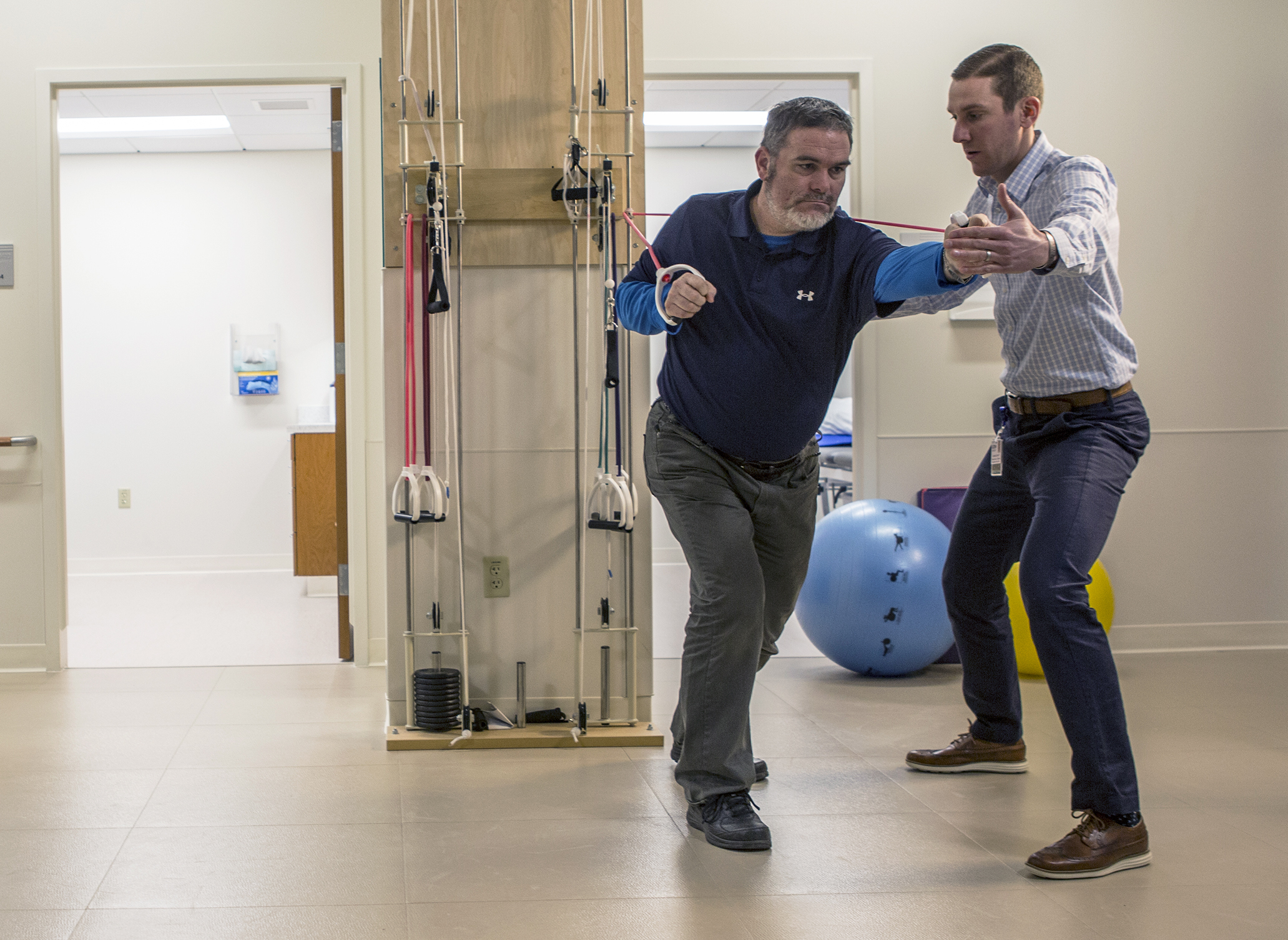A physical therapist works with his patient at UConn Health on Feb. 11, 2016. (Paul Horton/UConn Photo)
