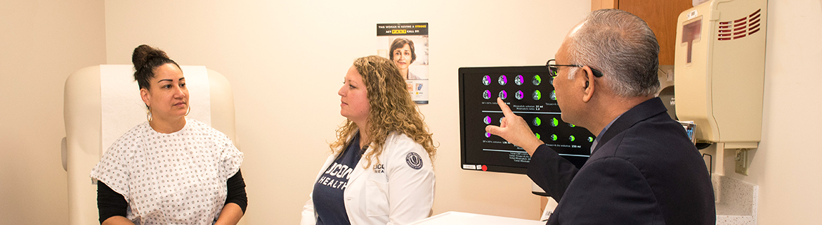 Sanjay Mittal, M.D., and Jennifer Sposito, R.N., M.S.N., with a stroke patient