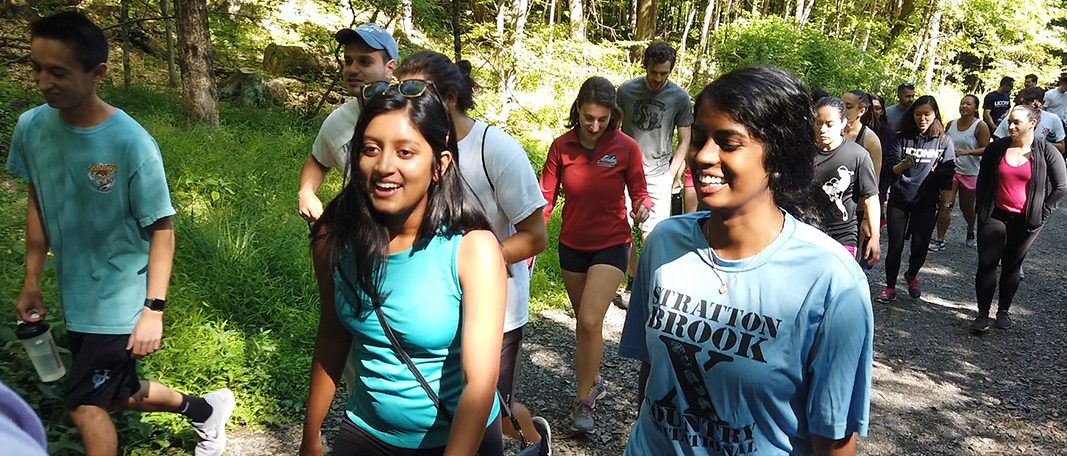 Students participate in a group hike to Heublein Tower