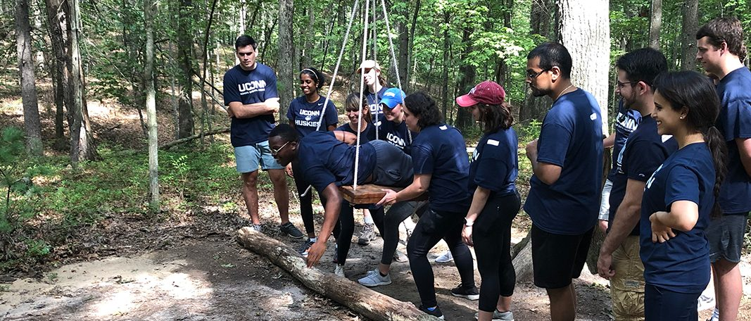 Students participating in an outdoor team building exercise at Winding Trails