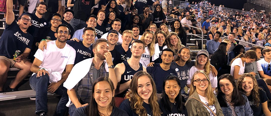 Medical and Dental students enjoying a UConn Football game