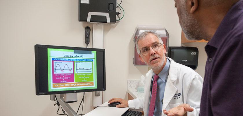 Dr. Bradley Biskup with patient