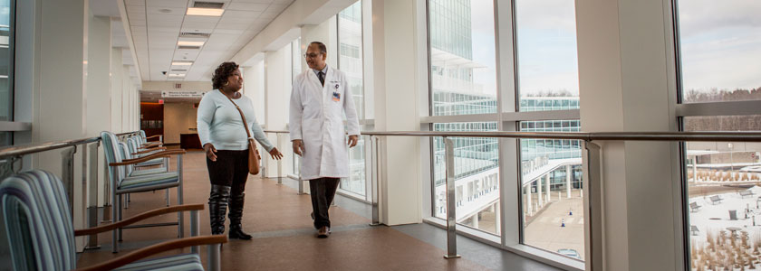A doctor walks with his patient at UConn Health
