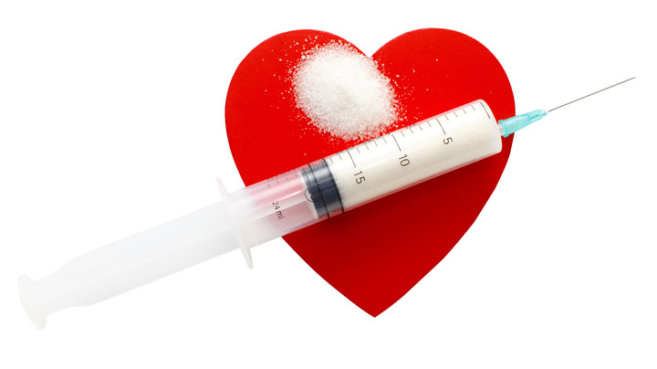 Heart with sugar in a needle