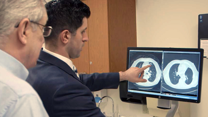 Dr. Omar Ibrahim with Gary, a lung cancer patient