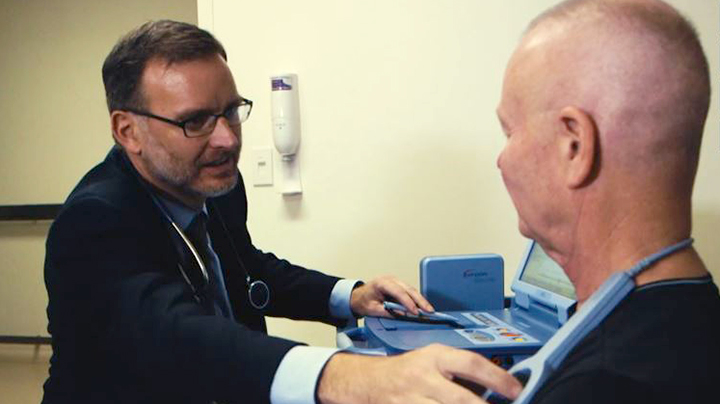 Dr. Christopher Pickett with Robert Dreier, a heart rhythm patient