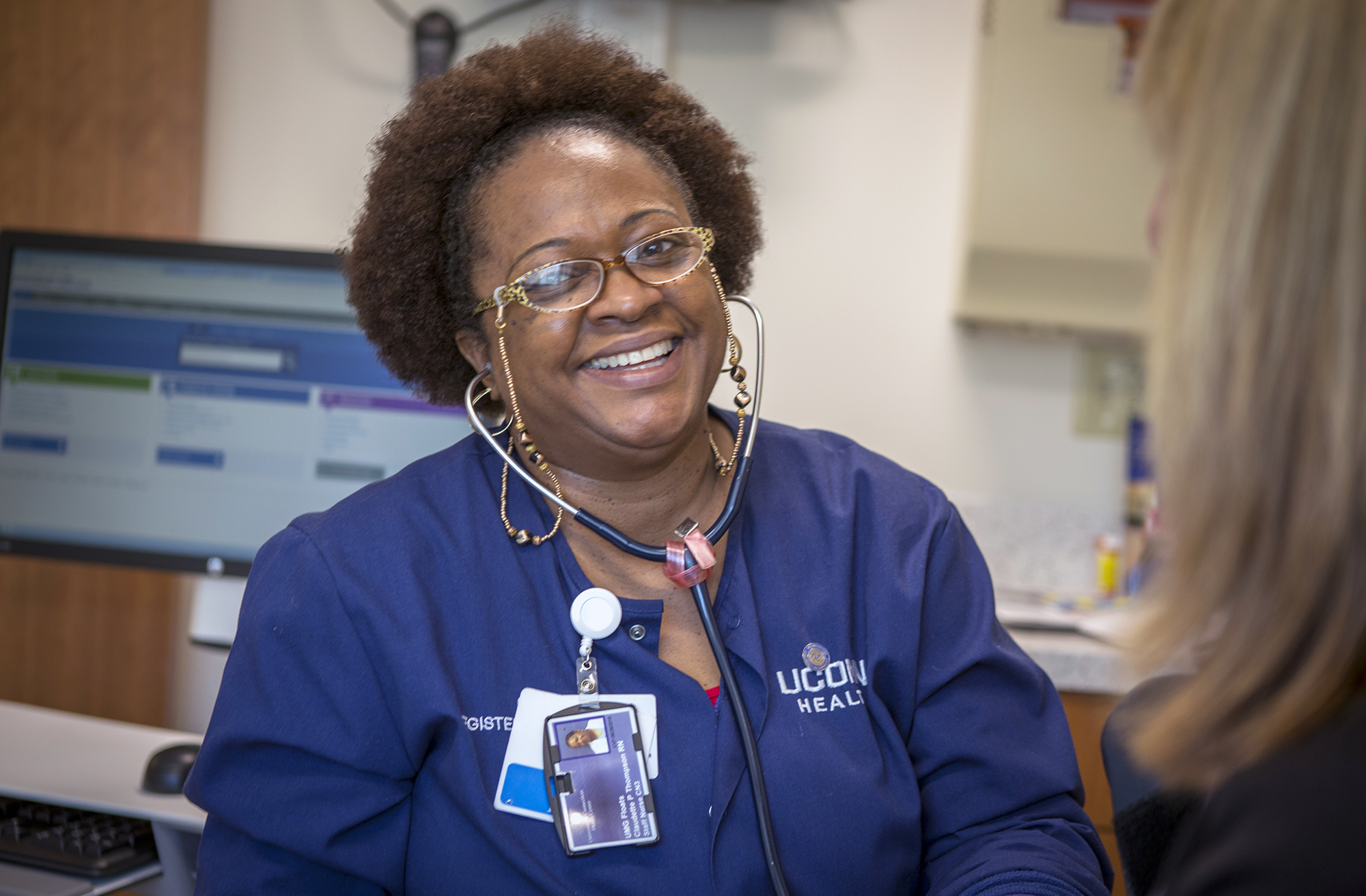 A nurse talks with a patient at UConn Health on Feb. 11, 2016. (Paul Horton/UConn Photo)