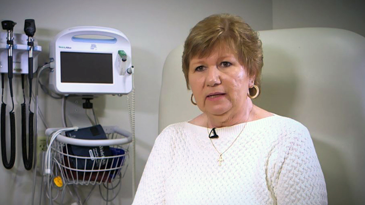 Charlotte, stroke survivor, sitting in a patient room