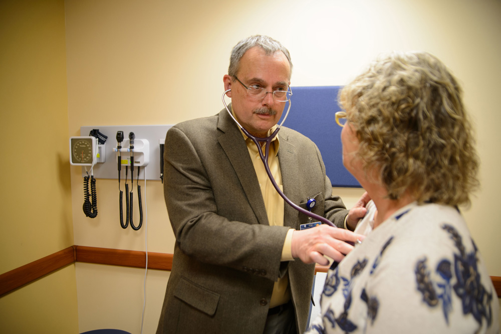 Craig Ryan MD,meets with a patient at UConn Health Urgent Care at Storrs Center