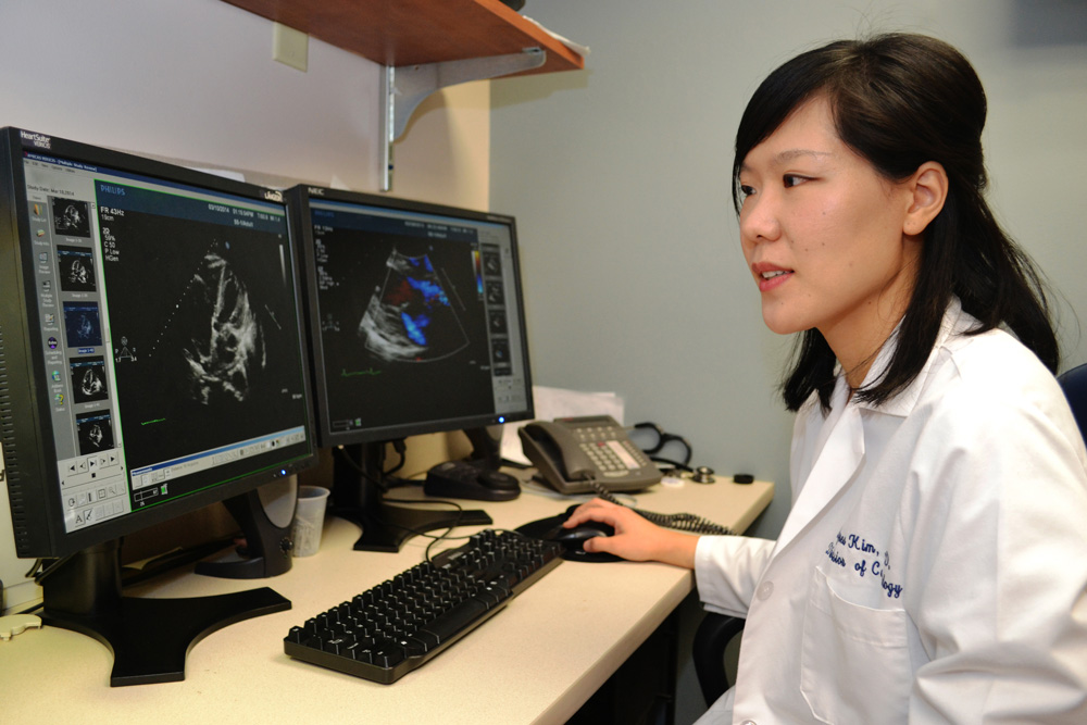 Reading echocardiography images is one way Dr. Agnes Kim monitors cancer survivors' risk for heart disease as UConn Health's Calhoun Cardiology Center grows its new cardio-oncology program