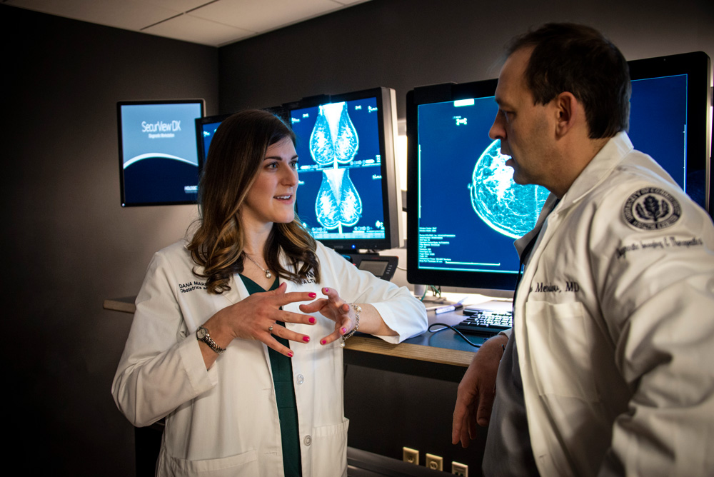 Dana Scott M.D., OB/GYN, discusses a patient diagnosis with Alex Merkulov, M.D., radiologist, head of women's imaging.