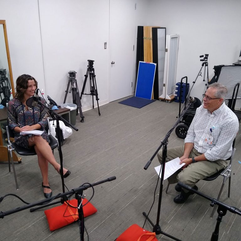 Tia Kozar and Dr. Steffens at microphones in podcast studio